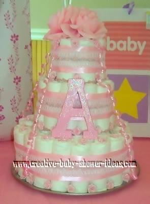 pink glitter monogram girl diaper cake