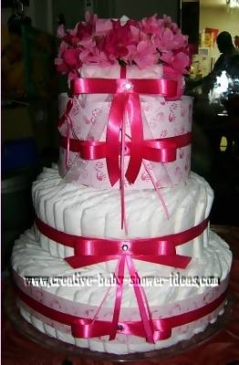 bright pink bow diaper cake with rhinestone accents