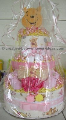wrapped pink winnie the pooh diaper cake