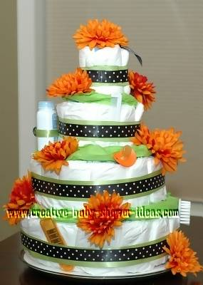 orange and green polka dot diaper cake