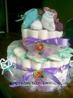 closeup of baby booties on winnie the pooh diaper cake
