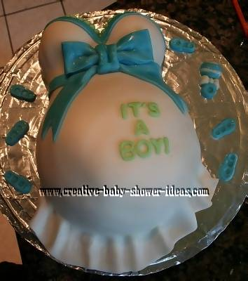 blue and white its a boy baby shower pregnant belly cake