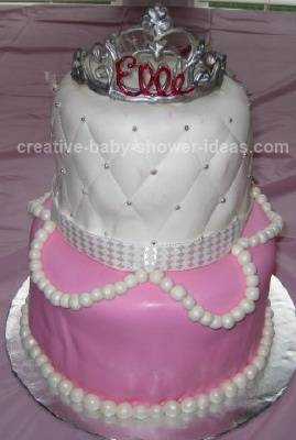 pink and white princess baby shower cake with pearls