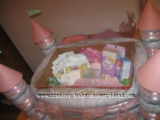 inside pink and white castle diaper cake