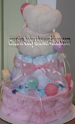 back of white and pink princess diaper cake