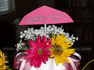 top of princess diaper cake pink umbrella with baby girl rhinestones