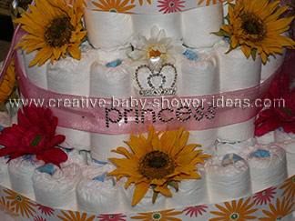 closeup of princess diaper cake with rhinestone crown