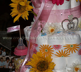 princess diaper cake with baby bottle towers