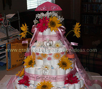 pink and yellow princess castle diaper cake