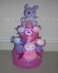 purple and pink princess diaper cake