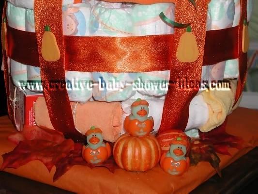 closeup of orange sparkly ribbon on pumpkin diaper cake