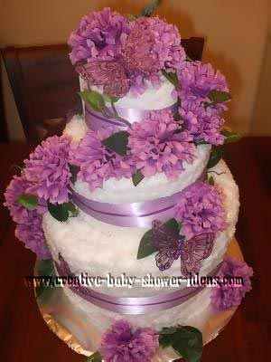purple and white carnations and butterflies wedding towel cake