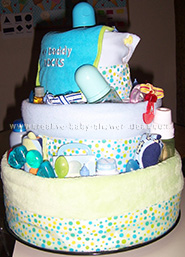 side view of boy diaper cake