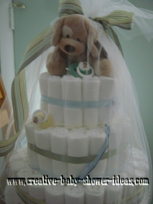 green and blue dog shower diaper cake