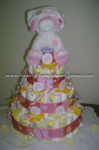 pink dog wit hat diaper cake