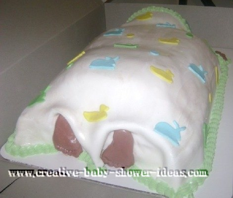 back of sleeping baby cake showing baby's toes peeking out