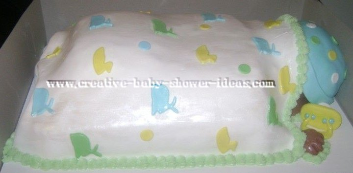 side of sleeping baby cake showing cute hand and pacifier