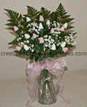 pink and white sock rose bouquet filled in with greenery and white baby's breath flowers