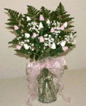 pink and white sock rose baby bouquet with baby's breath