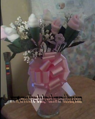 pink and white baby sock roses in vase