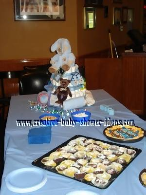 bear diaper cake on baby shower table