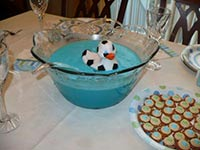 picture of baby food table with blue punch and a sports rubber duck floating in the punch