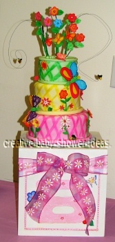 colorful pink yellow and green cake with bright flowers and bugs