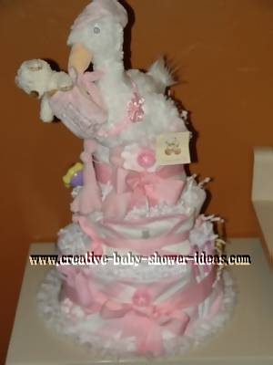 pink and white stork diaper cake