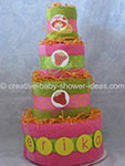 pink and green towel cake with as strawberry shortcake theme
