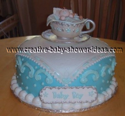 royal tea party cake with blue pillow white hankerchief and elegant edible tea cup on top
