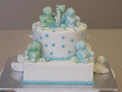 side view of blue teddy bear cake