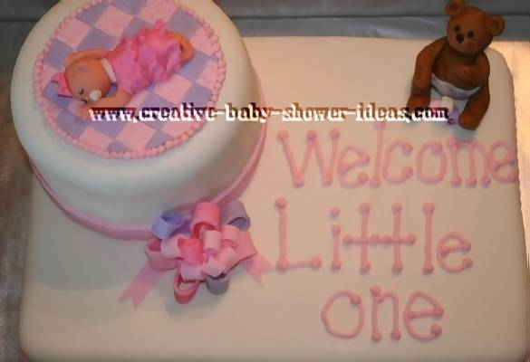pink purple and white baby shower cake