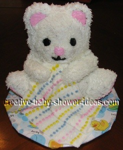 white teddy bear cake with blanket