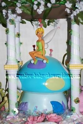 closeup of tinkerbell diaper cake sitting on mushroom bank