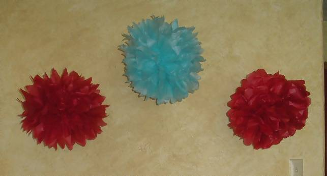 red and blue tissue pom poms