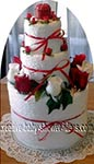 red and white flower towel cake