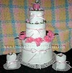 pink and white candle towel cake