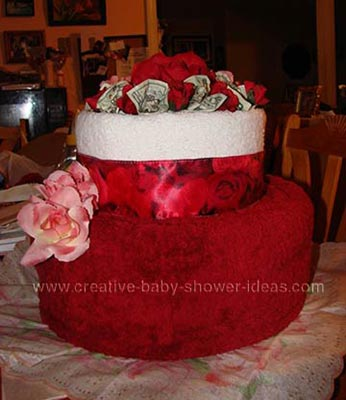 red flowers cash towel cake