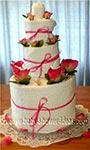 pink and white towel cake