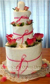 white and pink towel cake
