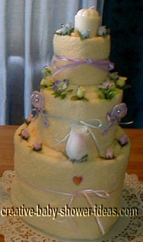cream and lavendar towel cake