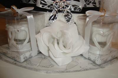 bottom of wedding towel cake with wedding candles