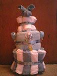 grey and white boo boo bunny towel cake
