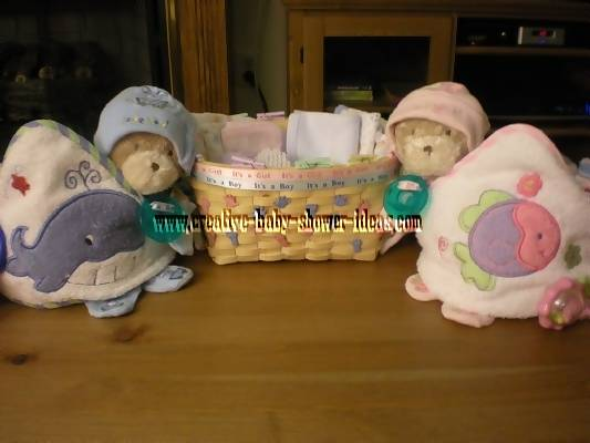 finised towel cupcakes with basket full of baby supplies