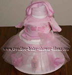 white towel cake dressed up with a pink tulle tutu skirt