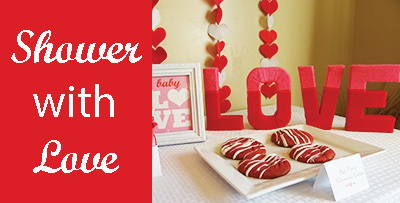 valentine baby shower with yarn letters and heart garland