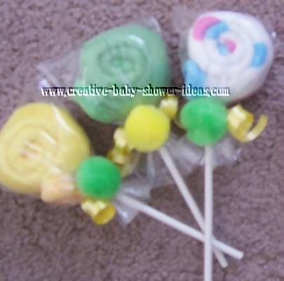 yellow green and blue washcloth lollipops