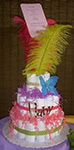 whimsical diaper cake with colorful feathers pink shredded paper and blue butterfly