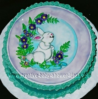 white bunny rabbit cake with teal frosting ruffled edges