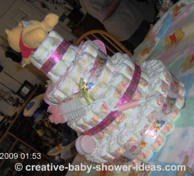 back view of pink winnie the pooh diaper cake
